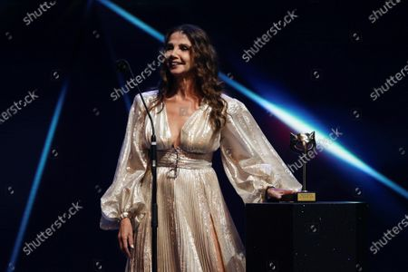 Stock Picture of Victoria Abril reacts after receiving the 'Feroz Honorary Award 2021' during  the 8th Feroz Awards gala at the Coliseum Theater in Madrid, Spain, 02 March 2021. The award handout ceremony acknowledges prominent works in Spanish cinema and television productions.