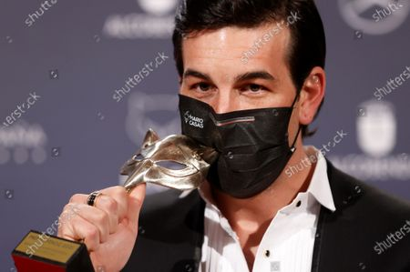 Mario Casas poses with his trophy after he receiving the 'Best Leading Actor in a Movie' award during the 8th Feroz Awards gala at the Coliseum Theater in Madrid, Spain, 02 March 2021. The award handout ceremony acknowledges prominent works in Spanish cinema and television productions.