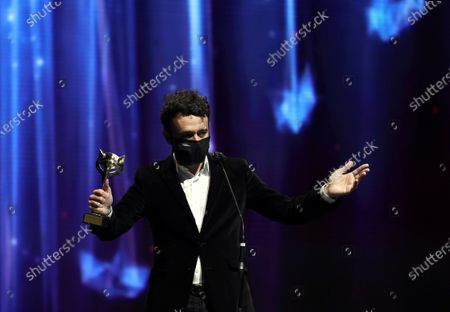"""Rodrigo Sorogoyen reacts after receiving the Best Dramatic Series Award for his work in """"Antidisturbios"""" (Anti-riot) during the 8th Feroz Awards gala at the Coliseum Theater in Madrid, Spain, 02 March 2021. The award handout ceremony acknowledges prominent works in Spanish cinema and television productions."""