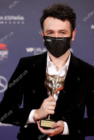"""Stock Picture of Rodrigo Sorogoyen poses with his trophy after receiving the Best Dramatic Series Award for his work in """"Antidisturbios"""" (Anti-riot) during the 8th Feroz Awards gala at the Coliseum Theater in Madrid, Spain, 02 March 2021. The award handout ceremony acknowledges prominent works in Spanish cinema and television productions."""