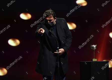 Stock Photo of Hovik Keuchkerian reacts as he receives the 'Best Leading Actor in a TV Series' award during the 8th Feroz Awards gala at the Coliseum Theater in Madrid, Spain, 02 March 2021. The award handout ceremony acknowledges prominent works in Spanish cinema and television productions.