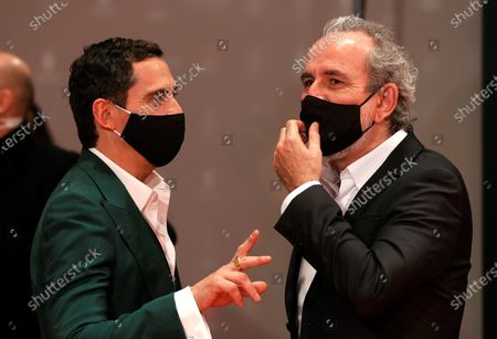 Stock Photo of Paco Leon (L) and Guillermo 'Willy' Toledo (R) pose on the red carpet during the 8th Feroz Awards gala at the Coliseum Theater in Madrid, Spain, 02 March 2021. The award handout ceremony acknowledges prominent works in Spanish cinema and television productions.