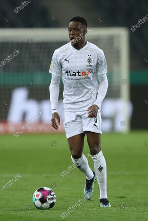 Denis Zakaria of Moenchengladbach runs with ball during the German DFB Cup quarter final match between Borussia Moenchengladbach and Borussia Dortmund at Borussia-Park in Moenchengladbach, Germany, 02 March 2021.