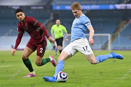Manchester City's Kevin De Bruyne (R) in action against Wolverhampton's Ki-Jana Hoever (L) during the English Premier League soccer match between Manchester City and Wolverhampton Wanderers in Manchester, Britain, 02 March 2021.