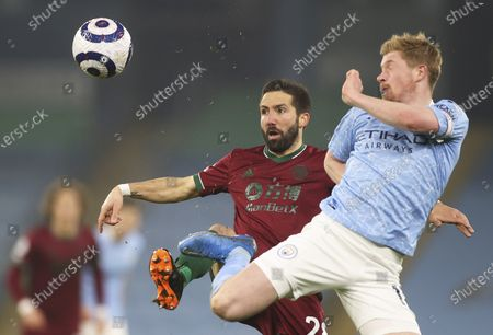 Manchester City's Kevin De Bruyne (R) in action against Wolverhampton's Joao Moutinho (L) during the English Premier League soccer match between Manchester City and Wolverhampton Wanderers in Manchester, Britain, 02 March 2021.