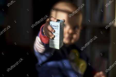 A baby holds a box of Vitamin D (Zyma D). According to several scientific studies vitamin D could help fight against the SARS-CoV-2. Vitamin D is also given to the infant as supplementation.