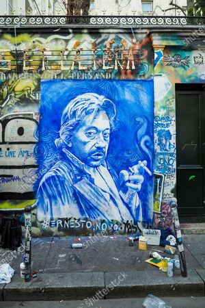 """The house of French singer Serge Gainsbourg """"l'homme a la tete de chou"""" covered with graffitis and street art on the wall of his home on the occasion of the 30th anniversary of the artist's death on March 02, 2021 in Paris, France. The singer and poet Serge Gainsbourg died on March 02, 1991, his daughter Charlotte Gainsbourg will open her house on rue de Verneuil to the public this year, which will make it a museum and a real place of pilgrimage for her fans."""