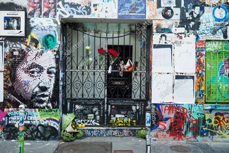 """Stock Image of Flowers and cabbages in front The house of French singer Serge Gainsbourg """"l'homme a la tete de chou"""" covered with graffitis and street art on the wall of his home on the occasion of the 30th anniversary of the artist's death on March 02, 2021 in Paris, France. The singer and poet Serge Gainsbourg died on March 02, 1991, his daughter Charlotte Gainsbourg will open her house on rue de Verneuil to the public this year, which will make it a museum and a real place of pilgrimage for her fans."""