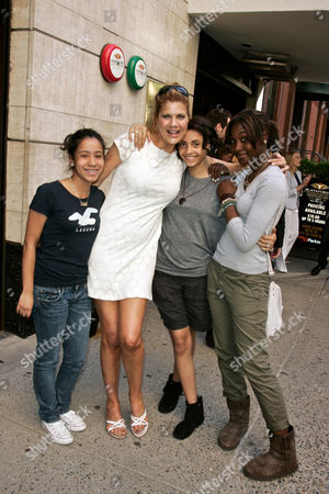 Kristen Johnson poses with school girls from the neighborhood