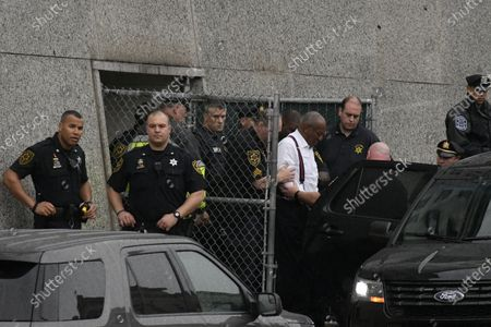 Bill Cosby is let out in handcuffs after hearing the sentence of three to ten years, at Montgomery Courthouse in Norristown, PA, on September 25, 2018. Cosby appeared before Judge Steven O'Neil after a jury found the 81 year old entertainer guilty of three counts of aggravated indecent assault in a April 2018 retrial.