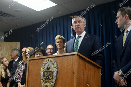 D.A. Kevin Steele, sided by Andrea Constand holds a press conference after Bill Cosby is let out in handcuffs after hearing the sentence of three to ten years, at Montgomery Courthouse in Norristown, PA, on September 25, 2018. Cosby appeared before Judge Steven O'Neil after a jury found the 81 year old entertainer guilty of three counts of aggravated indecent assault in a April 2018 retrial.