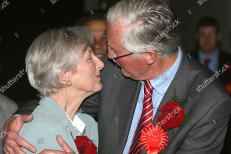 Labour's Candidate Michael Meacher kissing his wife as he is retained as MP for Oldham West and Royton