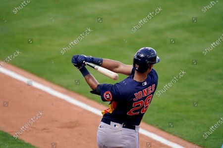 Houston Astros' Taylor Jones prepares to bat during the second inning of a spring training baseball game against the New York Mets, in Port St. Lucie, Fla