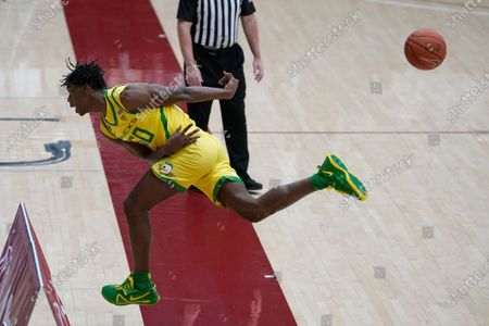 Oregon forward Eric Williams Jr. (50) saves the ball from going out of bounds against Stanford during an NCAA college basketball game in Stanford, Calif