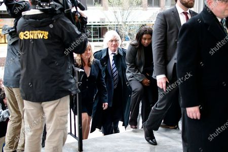 Bill Cosby's legal defense team with lead attorneys Tom Mesereau (center) and Kathleen Bliss take a break outside the court house during day 13 of the actor and comedian's sexual assault trial at the Montgomery County Court House, in Norristown, PA, on April 25, 2018.
