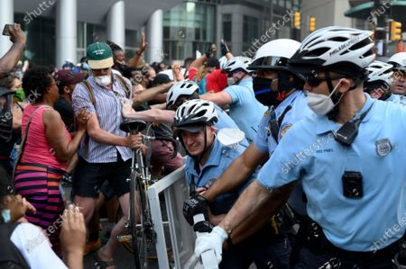 Police officers and protestors clash in Center City Philadelphia, PA on may 30, 2020. The police unite responding falls under supervisor on Staff Inspector Joseph Bologna Jr., who on June 5th was removed from street duty after a video surfaced of excessive use of force against protestors.