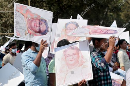 Members of the Bangladesh Chhatra League hold image placards of Bangladeshi Prime Minister  Sheikh Hasina as they attend a rally in Dhaka University Area in Dhaka, Bangladesh on March 02, 2021.