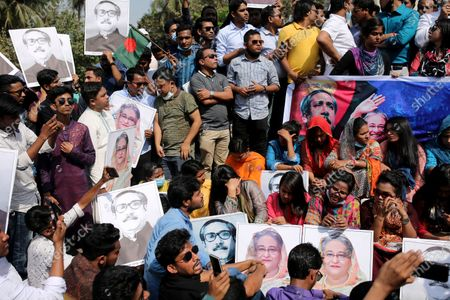 Members of the Bangladesh Chhatra League hold image placards of Bangladeshi Prime Minister  Sheikh Hasina and Her Fater Sheikh Mujibur Rahman as they attend a rally in Dhaka University Area in Dhaka, Bangladesh on March 02, 2021.