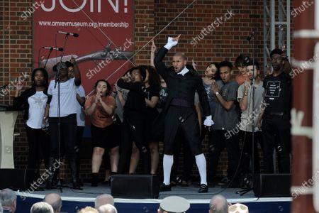 """Sydney James Harcourt, original cast member of """"Hamilton,"""" performs with local high school students during the official opening's ceremony of the Museum of the American Revolution, in Philadelphia, PA, on April 19, 2017."""