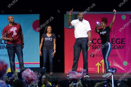 NBA Legend Dikembe Mutombo shares the stage during an event with Michelle Obama to promote higher education, at Temple University's Liacouras Center, in Philadelphia, PA on May 2, 2018. The Former First Lady is joined by 7.000 students and (on stage) stars, performing artists and athletes including Bradley Cooper, Rebel Wilson, Zendaya, Robert De Niro, Camila Cabello, Questlove, Anthony Mackie and Janelle Monae.