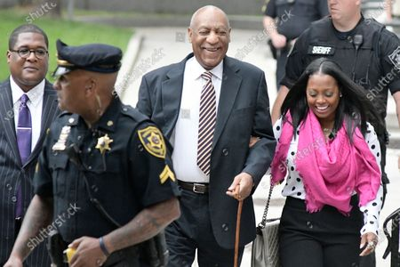 Bill Cosby arrives, sided by Cosby Show actress Keshia Knight Pulliam, at the Montgomery County Courthouse for the start day of the sexual assault trail in Norristown, Pennsylvania, on June 5, 2017.