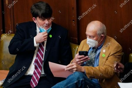 House Medicaid Committee chairman Joey Hood, R-Ackerman, left, confers with Rep. Larry Byrd, R-Petal following a committee meeting, at the Capitol in Jackson, Miss. Lawmakers are under a deadline for committees to report on general bills and constitutional amendments that originated in the other House