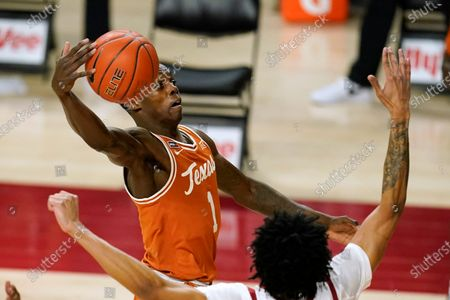 Texas guard Andrew Jones (1) drives to the basket during the first half of an NCAA college basketball game against Iowa State, in Ames, Iowa