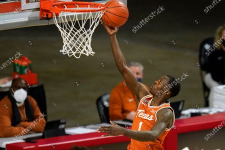 Texas guard Andrew Jones drives to the basket during the second half of an NCAA college basketball game against Iowa State, in Ames, Iowa. Texas won 81-67