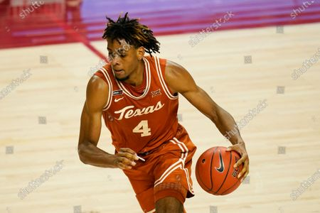 Texas forward Greg Brown drives up court during the second half of an NCAA college basketball game against Iowa State, in Ames, Iowa. Texas won 81-67