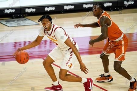 Iowa State forward Javan Johnson drives around Texas guard Andrew Jones, right, during the second half of an NCAA college basketball game, in Ames, Iowa. Texas won 81-67