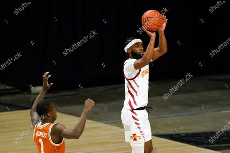 Iowa State guard Tre Jackson shoots ahead of Texas guard Andrew Jones, left, during the first half of an NCAA college basketball game, in Ames, Iowa