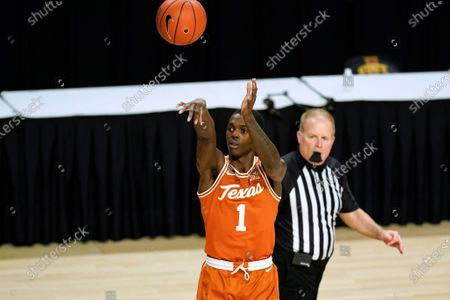 Texas guard Andrew Jones shoots during the first half of an NCAA college basketball game against Iowa State, in Ames, Iowa