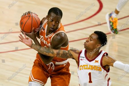 Texas guard Andrew Jones catches a pass over Iowa State guard Tyler Harris, right, during the first half of an NCAA college basketball game, in Ames, Iowa