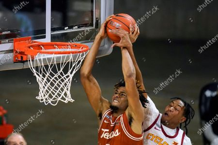 Texas forward Greg Brown is fouled by Iowa State forward Javan Johnson, right, while driving to the basket during the second half of an NCAA college basketball game, in Ames, Iowa. Texas won 81-67