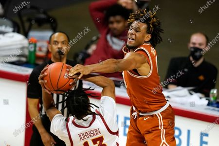 Texas forward Greg Brown, right, tries to block a shot by Iowa State forward Javan Johnson during the second half of an NCAA college basketball game, in Ames, Iowa. Texas won 81-67