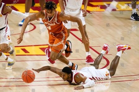 Texas forward Greg Brown (4) fights for a loose ball with Iowa State guard Jalen Coleman-Lands during the second half of an NCAA college basketball game, in Ames, Iowa. Texas won 81-67