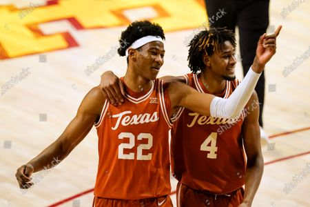 Texas' Kai Jones (22) walks off the court with teammate Greg Brown (4) after an NCAA college basketball game against Iowa State, in Ames, Iowa. Texas won 81-67