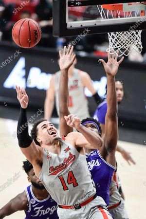 Texas Tech's Marcus Santos-Silva (14) shoots during the first half of the team's NCAA college basketball game against TCU in Lubbock, Texas