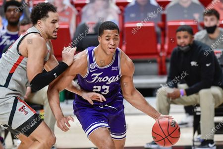 TCU's Jaedon Ledee (23) controls the ball against Texas Tech's Marcus Santos-Silva (14) during the second half of an NCAA college basketball game in Lubbock, Texas