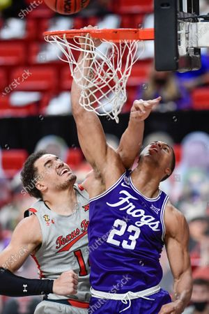 TCU's Jaedon Ledee (23) attempts to shoot the ball under Texas Tech's Marcus Santos-Silva (14) during the second half of an NCAA college basketball game in Lubbock, Texas