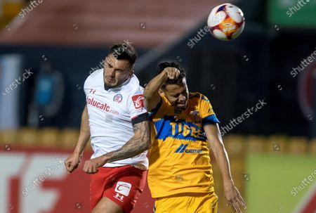 Diego Reyes (R) of Tigres UANL in action against Enrique Triverio (L) of Toluca during the Liga MX Clausura Tournament soccer match between Tigres UANL and Toluca at the University Stadium in Monterrey, Mexico, 02 March 2021.