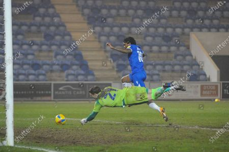 Carlisles Paul Farman tips the ball away from Colchesters Jevani Brown during the Sky Bet League 2 match between Colchester United and Carlisle United at the Weston Homes Community Stadium, Colchester on Tuesday 2nd March 2021.