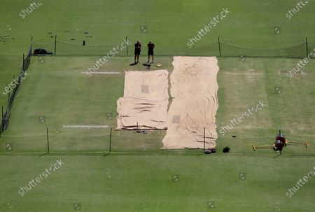 Stock Picture of England team head coach Chris Silverwood, left, and assistant coach Paul Collingwood inspect the pitch area during a training session ahead of the fourth test cricket match between India and England at Narendra Modi Stadium in Ahmedabad, India