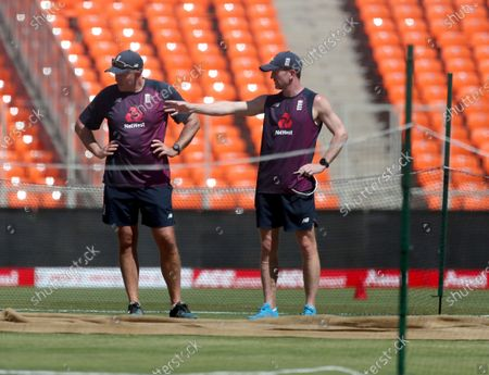England team head coach Chris Silverwood, left, and assistant coach Paul Collingwood inspect the pitch area during a training session ahead of the fourth test cricket match between India and England at Narendra Modi Stadium in Ahmedabad, India