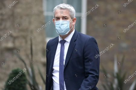 Britain's Stephen Barclay, Chief Secretary to the Treasury arrives in Downing Street in London, . The Chancellor of the Exchequer Rishi Sunak will announce his new Budget later in parliament
