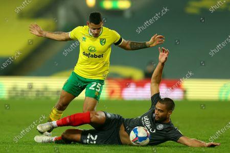 Onel Hernandez of Norwich City fouls Winston Reid of Brentford; Carrow Road, Norwich, Norfolk, England, English Football League Championship Football, Norwich versus Brentford.