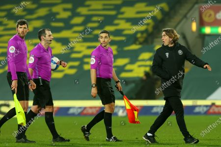 Brentford Manager Thomas Frank has words with referee Tim Robinson after the 1-0 loss; Carrow Road, Norwich, Norfolk, England, English Football League Championship Football, Norwich versus Brentford.