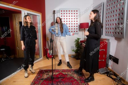 English indie folk trio, The Staves, from left, sisters Emily, Camilla and Jessica Staveley-Taylor rehearse a song in a north London recording studio, following the launch of their new album 'Good Woman