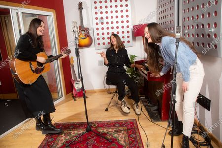 English indie folk trio, The Staves, from left, sisters, Jessica, Emily and Camilla Staveley-Taylor rehearse a song in a north London recording studio, following the launch of their new album 'Good Woman