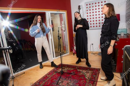 English indie folk trio, The Staves, from left, sisters Camilla, Jessica and Emily Staveley-Taylor rehearse a song in a north London recording studio, following the launch of their new album 'Good Woman